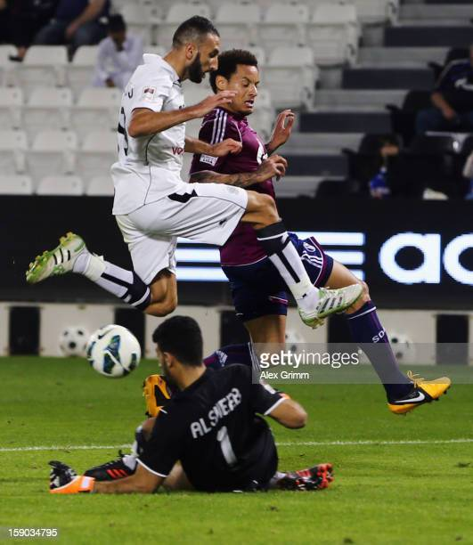 Jermaine Jones of Schalke tries to score against Nadir Belhadj of Al Sadd during the friendly match between AlSadd Sports Club and FC Schalke 04 at...