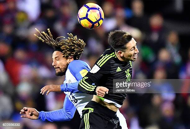 Jermaine Jones of the United States and Hector Herrera of Mexico head the ball in the first half during the FIFA 2018 World Cup Qualifier at MAPFRE...