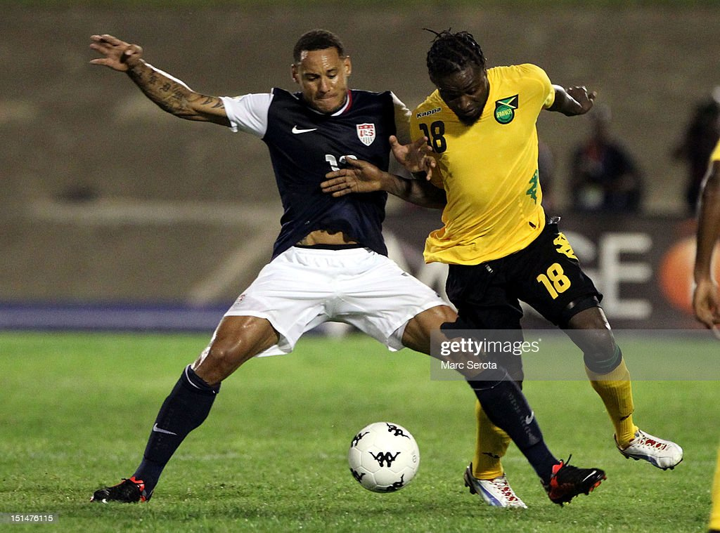 Jermaine Jones #13 of the united States battles for the ball with Kavin Bryan #18 of Jamaica during the United States and Jamaica World Cup Qualifier at National Stadium on September 7, 2012 in Kingston, Jamaica.