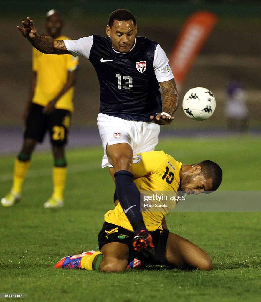 Jermaine Jones of the United States battles for the ball with Omar Cummings of Jamaica during the United States and Jamaica World Cup Qualifier at...