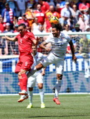 Jermaine Jones of the United States heads the ball as Mevlut Erdinc of Turkey defends during an international friendly match at Red Bull Arena on...