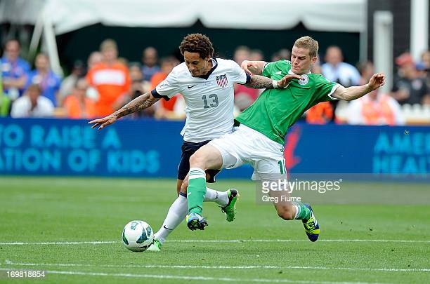 Jermaine Jones of the United States Men's National Team battles for the ball against Sven Bender of the Germany Men's National Team in an...