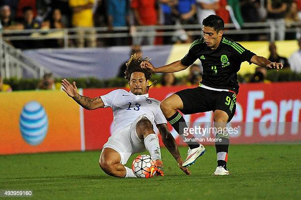 Jermaine Jones of the United States slides in front of Raul Jimenez of Mexico during the 2017 FIFA Confederations Cup Qualifier at Rose Bowl on...
