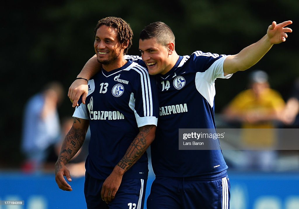 Jermaine Jones smiles with Kyriakos Papadopolous during a FC Schalke 04 training session on August 22, 2013 in Gelsenkirchen, Germany.