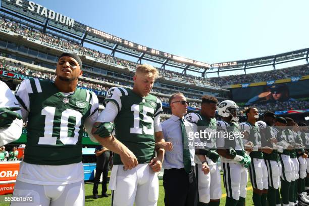 Jermaine Kearse and Josh McCown of the New York Jets stand in unison with their team during the National Anthem prior to an NFL game against the...