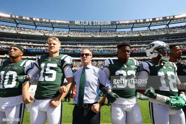 Jermaine Kearse Josh McCown Jamal Adams ArDarius Stewart and Christopher Johnson CEO of the New York Jets stand in unison with his team during the...