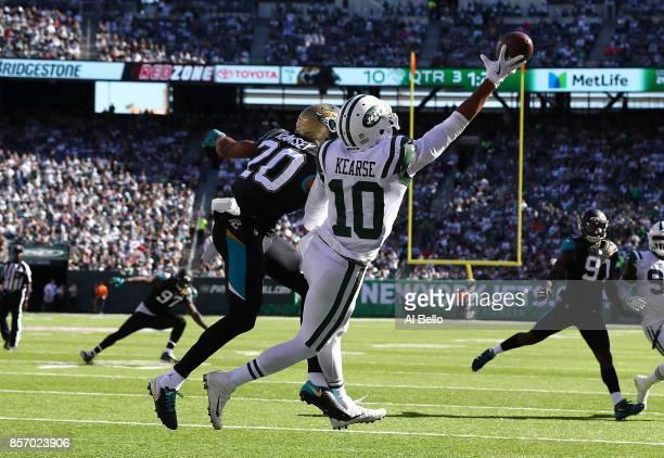 Jermaine Kearse of the New York Jets misses a ball against Jalen Ramsey of the Jacksonville Jaguars during their game at MetLife Stadium on October 1...
