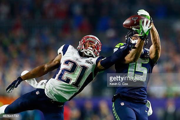 Jermaine Kearse of the Seattle Seahawks and Malcolm Butler of the New England Patriots stretch to catch the ball in the third quarter during Super...