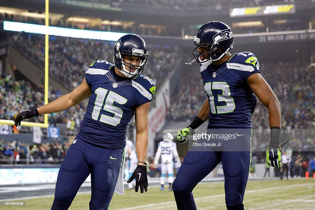 Jermaine Kearse #15 of the Seattle Seahawks celebrates with Chris Matthews #13 after scoring a 63 yard touchdown in the second quarter against the Carolina Panthers during the 2015 NFC Divisional Playoff game at CenturyLink Field on January 10, 2015 in Seattle, Washington.