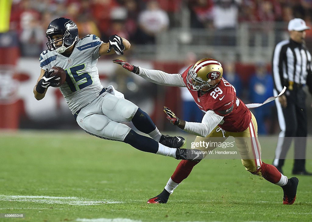 Jermaine Kearse #15 of the Seattle Seahawks gets airborne against Chris Culliver #29 of the San Francisco 49ers in the first half at Levi's Stadium on November 27, 2014 in Santa Clara, California.