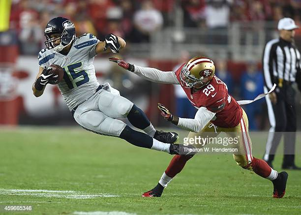 Jermaine Kearse of the Seattle Seahawks gets airborne against Chris Culliver of the San Francisco 49ers in the first half at Levi's Stadium on...
