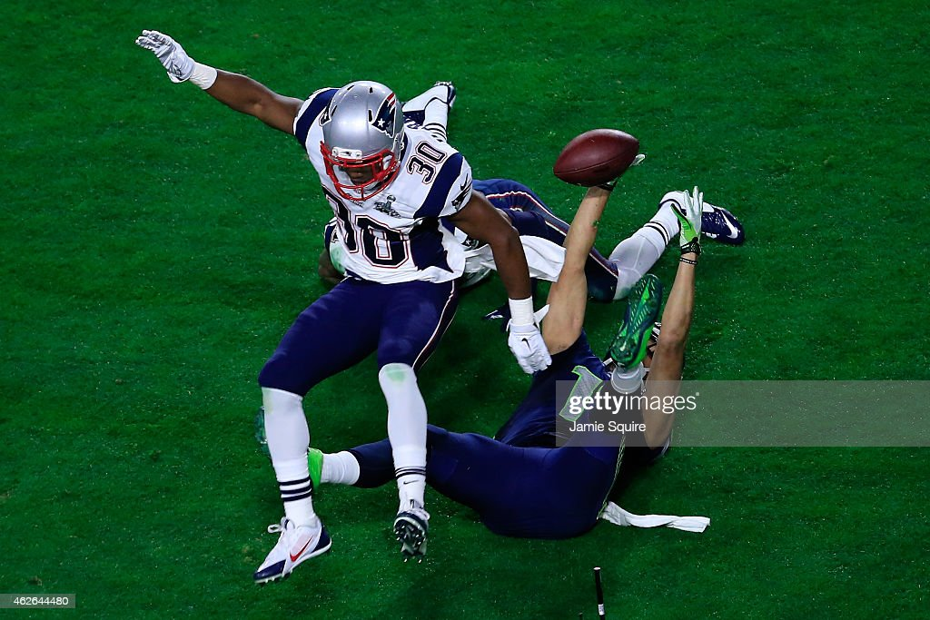 Jermaine Kearse #15 of the Seattle Seahawks makes a catch against Malcolm Butler #21 and Duron Harmon #30 of the New England Patriots in the fourth quarter during Super Bowl XLIX at University of Phoenix Stadium on February 1, 2015 in Glendale, Arizona.