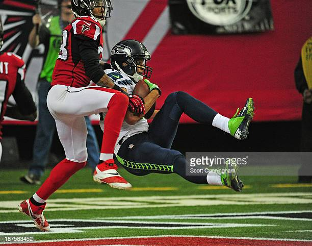 Jermaine Kearse of the Seattle Seahawks makes a catch for a touchdown against Thomas DeCoud of the Atlanta Falcons at the Georgia Dome on November 10...