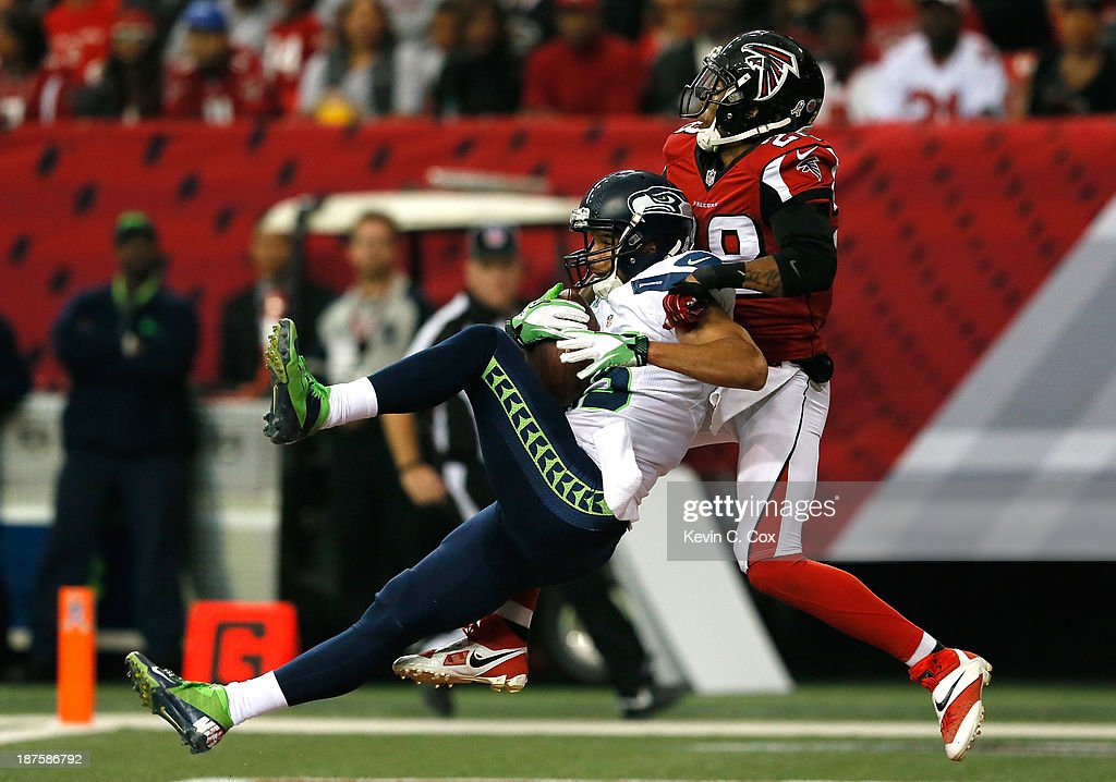 Jermaine Kearse #15 of the Seattle Seahawks pulls in this touchdown reception against Thomas DeCoud #28 of the Atlanta Falcons at Georgia Dome on November 10, 2013 in Atlanta, Georgia.