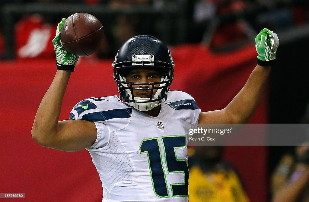 Jermaine Kearse #15 of the Seattle Seahawks reacts after pulling in a touchdown against Thomas DeCoud #28 of the Atlanta Falcons at Georgia Dome on November 10, 2013 in Atlanta, Georgia.