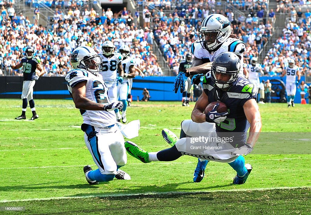 <a gi-track='captionPersonalityLinkClicked' href=/galleries/search?phrase=Jermaine+Kearse&family=editorial&specificpeople=5516767 ng-click='$event.stopPropagation()'>Jermaine Kearse</a> #15 of the Seattle Seahawks scores the game-winning touchdown as Josh Norman #22 and <a gi-track='captionPersonalityLinkClicked' href=/galleries/search?phrase=Charles+Godfrey&family=editorial&specificpeople=1759557 ng-click='$event.stopPropagation()'>Charles Godfrey</a> #30 defend during pthe fourth quarter at Bank of America Stadium on September 8, 2013 in Charlotte, North Carolina. Seattle won 12-7.