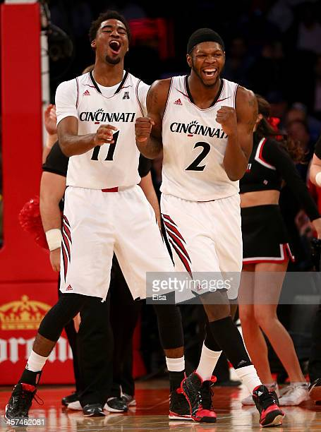Jermaine Lawrence and Titus Rubles of the Cincinnati Bearcats celebrate the win over the Pittsburgh Panthers during the Jimmy V Classic at Madison...