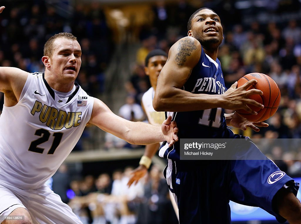 Jermaine Marshall #11 of the Penn State Nittany Lions goes to the hoop as D.J. Byrd #21 of the Purdue Boilermakers trails at Mackey Arena on January 13, 2013 in West Lafayette, Indiana. Purdue defeated Penn State 60-42.