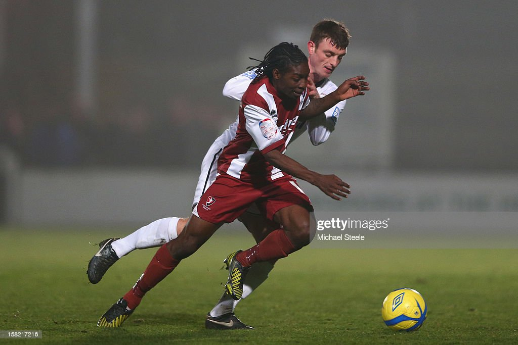 Jermaine McGlashan of Cheltenham Town is challenged by Joe Heath of Hereford United and during the FA Cup with Budweiser Second Round Replay match between Hereford United and Cheltenham Town at Edgar Street Athletic Ground on December 11, 2012 in Hereford, England.