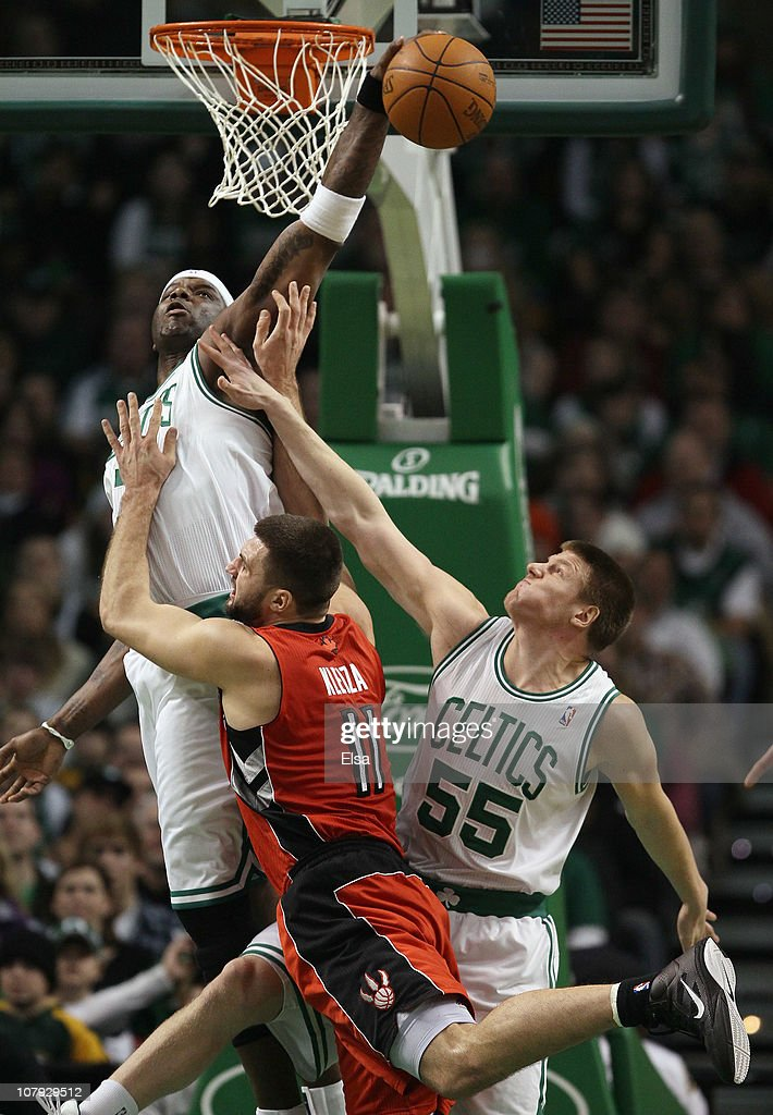 Jermaine O'Neal of the Boston Celtics blocks a shot by Linas Kleiza of the Toronto Raptors as Luke Harangody of the Celtics fouls on January 7 2011...