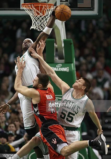 Jermaine O'Neal of the Boston Celtics blocks a shot by Linas Kleiza of the Toronto Raptors as Luke Harangody of the Celtics fouls on January 7 2011...