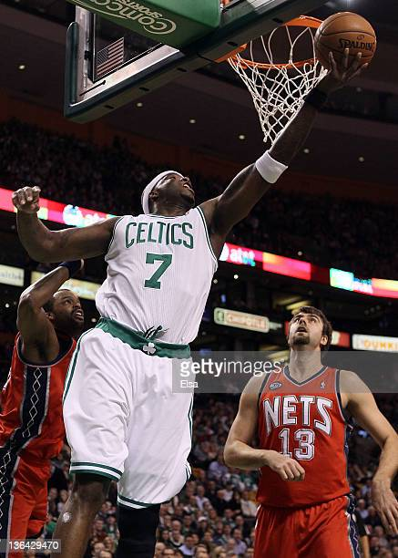 Jermaine O'Neal of the Boston Celtics heads for the basket as Shelden Williams and Mehmet Okur of the New Jersey Nets defend on January 4 2012 at TD...