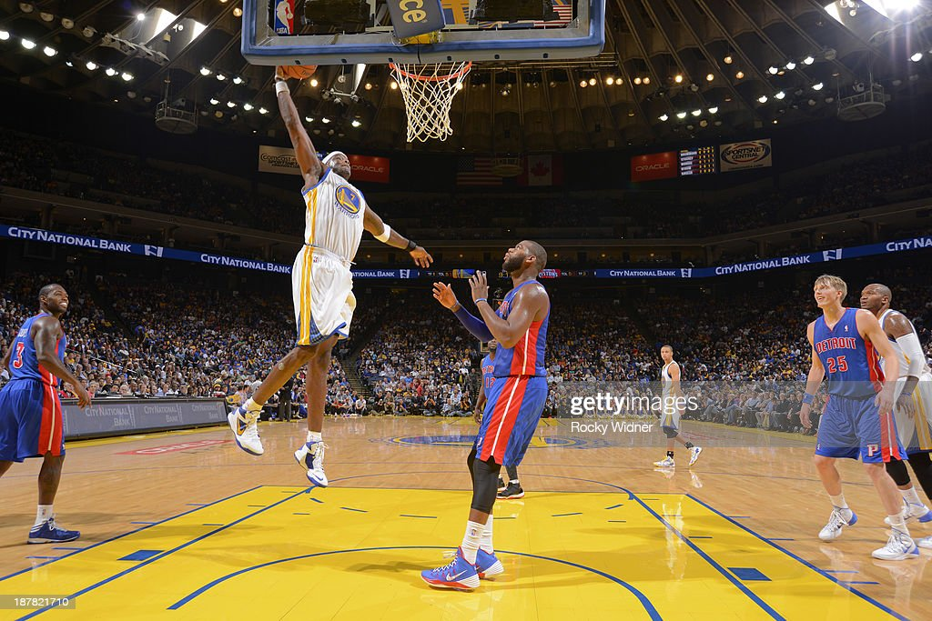 Jermaine O'Neal #7 of the Golden State Warriors dunks against Greg Monroe #10 of the Detroit Pistons on November 12, 2013 at Oracle Arena in Oakland, California.