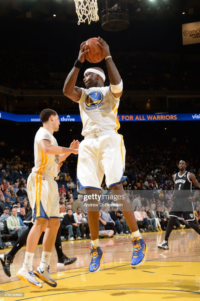 <a gi-track='captionPersonalityLinkClicked' href=/galleries/search?phrase=Jermaine+O%27Neal&family=editorial&specificpeople=201524 ng-click='$event.stopPropagation()'>Jermaine O'Neal</a> #7 of the Golden State Warriors grabs a rebound against the Brooklyn Nets at Oracle Arena on February 22, 2014 in Oakland, California.