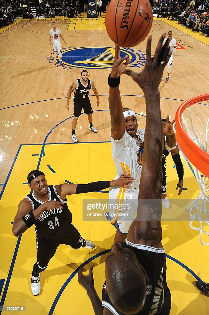 <a gi-track='captionPersonalityLinkClicked' href=/galleries/search?phrase=Jermaine+O%27Neal&family=editorial&specificpeople=201524 ng-click='$event.stopPropagation()'>Jermaine O'Neal</a> #7 of the Golden State Warriors shoots against the Brooklyn Nets at Oracle Arena on February 22, 2014 in Oakland, California.