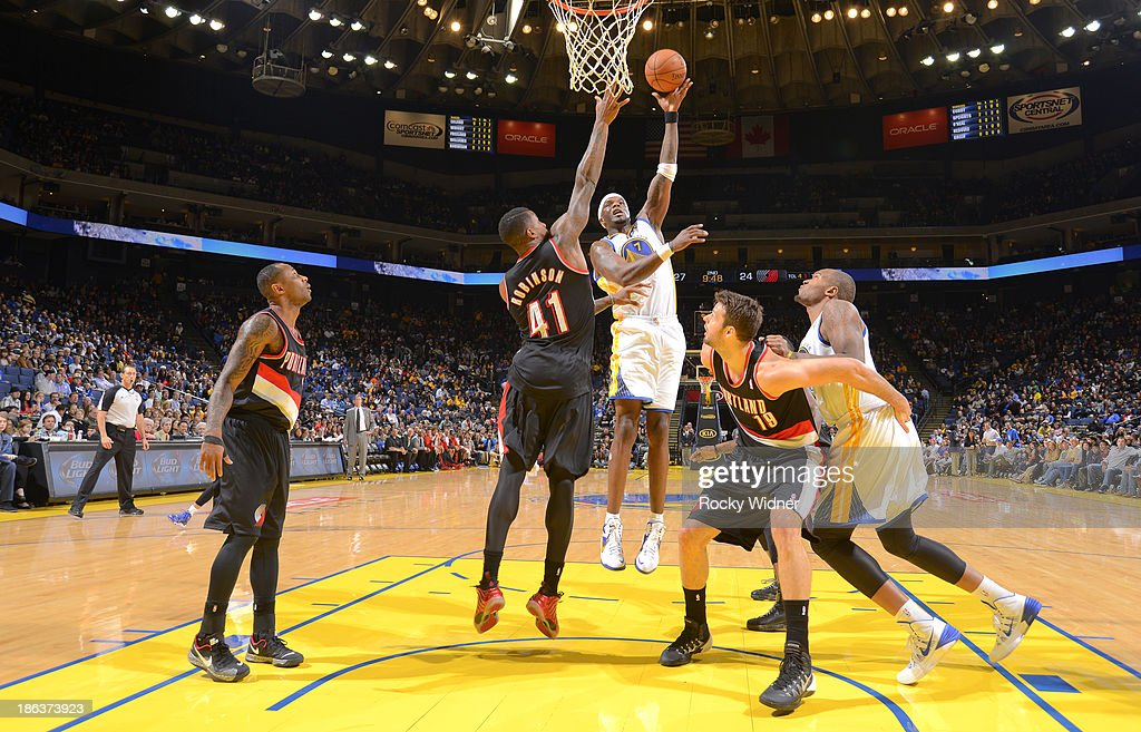 <a gi-track='captionPersonalityLinkClicked' href=/galleries/search?phrase=Jermaine+O%27Neal&family=editorial&specificpeople=201524 ng-click='$event.stopPropagation()'>Jermaine O'Neal</a> #7 of the Golden State Warriors shoots against Thomas Robinson #41 of the Portland Trail Blazers on October 24, 2013 at Oracle Arena in Oakland, California.
