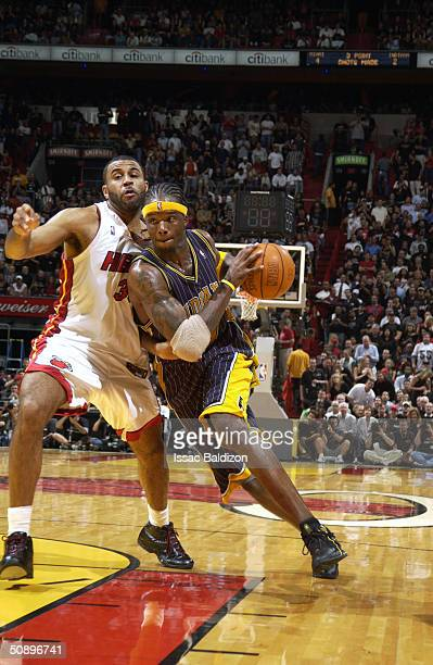 Jermaine O'Neal of the Indiana Pacers drives around Malik Allen of the Miami Heat in Game four of the Eastern Conference Semifinals during the 2004...