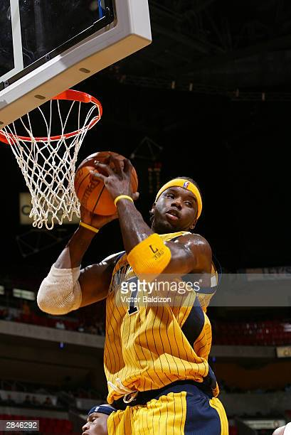 Jermaine O'Neal of the Indiana Pacers grabs a rebound against the Miami Heat during NBA action on January 5 2004 at American Airlines Arena in Miami...
