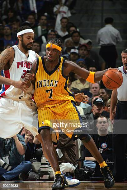 Jermaine O'Neal of the Indiana Pacers is defended by Rasheed Wallace of the Detroit Pistons in Game Four of the Eastern Conference Finals during the...