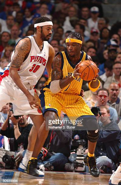 Jermaine O'Neal of the Indiana Pacers looks to make a play against Rasheed Wallace of the Detroit Pistons in game six of the Eastern Conference...