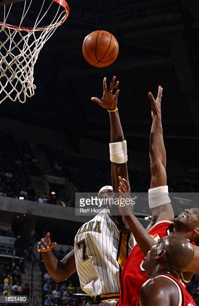 Jermaine O'Neal of the Indiana Pacers puts up a shot against Shareef AbdurRahim of the Atlanta Hawks the NBA game at Conseco Fieldhouse on February...