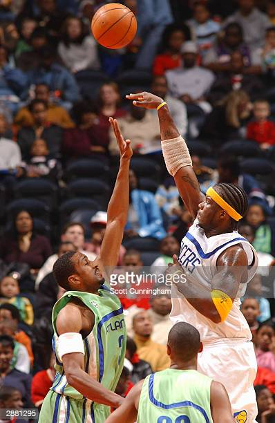 Jermaine O'Neal of the Indiana Pacers shoots over Shareef AbdurRahim of the Atlanta Hawks on January 19 2004 at Philips Arena in Atlanta Georgia NOTE...