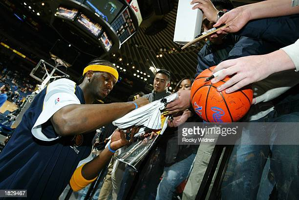 Jermaine O'Neal of the Indiana Pacers signs autographs before his game against the Golden State Warriors at The Arena in Oakland on March 4 2003 in...