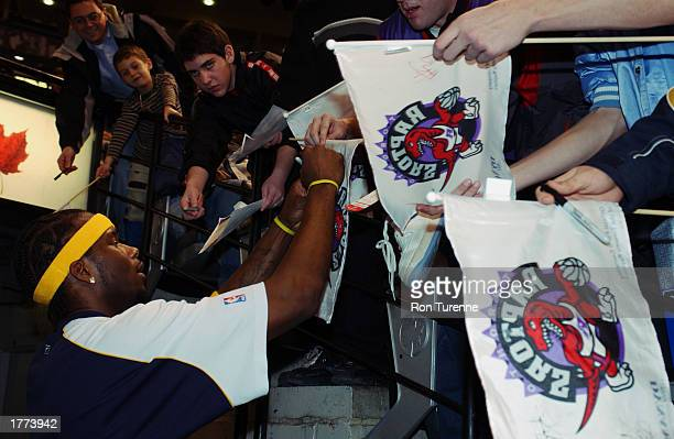 Jermaine O'Neal of the Indiana Pacers signs autographs for the fans prior to the NBA game against the Toronto Raptors at Air Canada Centre on January...