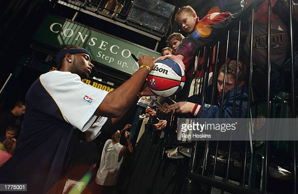 Jermaine O'Neal of the Indiana Pacers signs autographs for the fans prior to the NBA game against the Boston Celtics at Conseco Fieldhouse on...