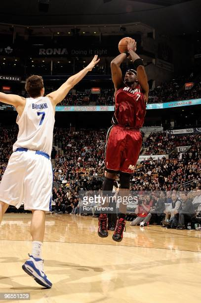 Jermaine O'Neal of the Miami Heat shoots against Andrea Bargnani of the Toronto Raptors during the game on January 27 2010 at Air Canada Centre in...