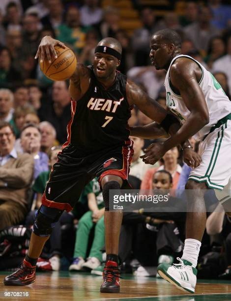 Jermaine O'Neal of the Miami Heat tries to hang on to the ball as Kendrick Perkins of the Boston Celtics defends during Game Five of the Eastern...