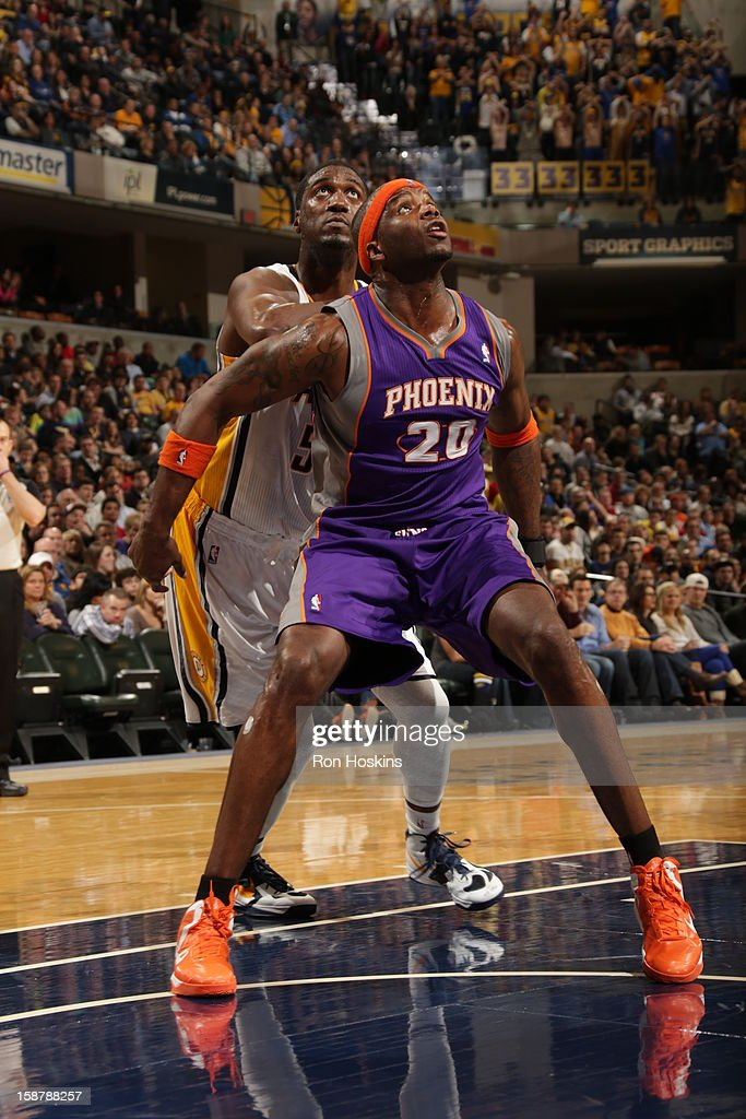 Jermaine O'Neal #20 of the Phoenix Suns battles for positioning against Roy Hibbert #55 of the Indiana Pacers on December 28, 2012 at Bankers Life Fieldhouse in Indianapolis, Indiana.