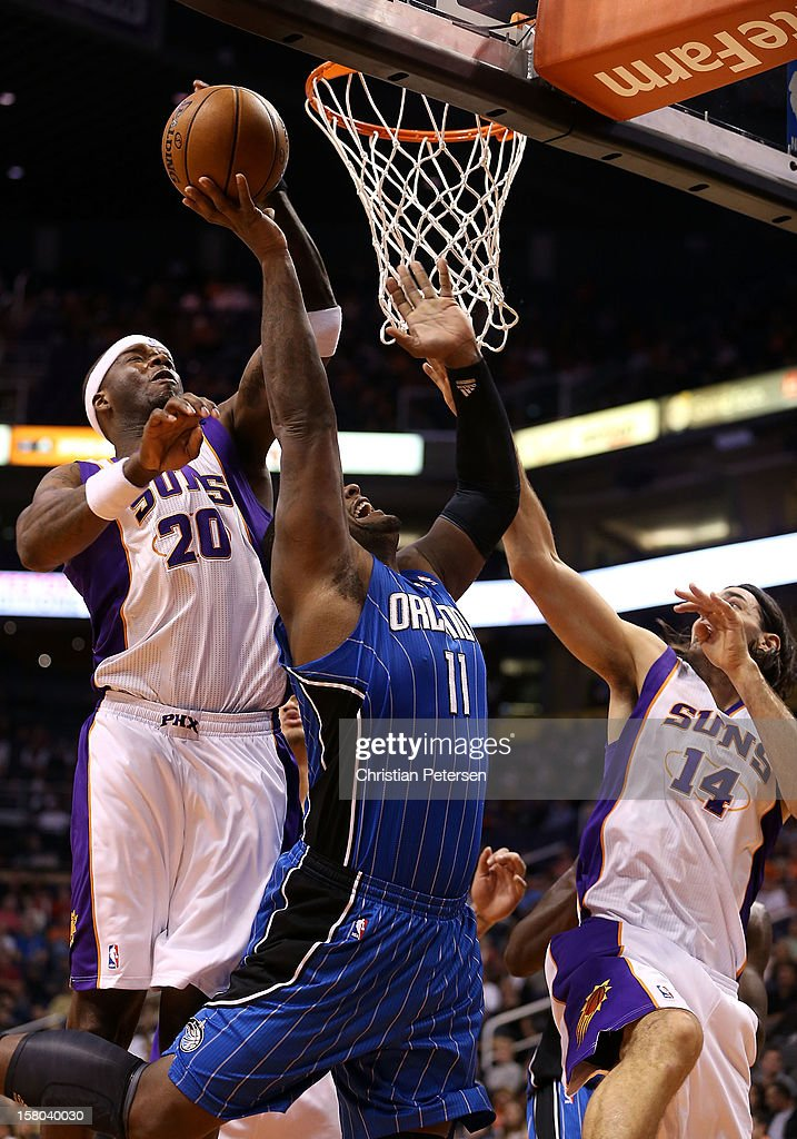 Jermaine O'Neal #20 of the Phoenix Suns blocks a shot attempt from Glen Davis #11 of the Orlando Magic during the NBA game at US Airways Center on December 9, 2012 in Phoenix, Arizona.