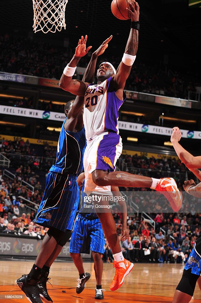 Jermaine O'Neal #20 of the Phoenix Suns drives for a shot against the Orlando Magic on December 9, 2012 at U.S. Airways Center in Phoenix, Arizona.