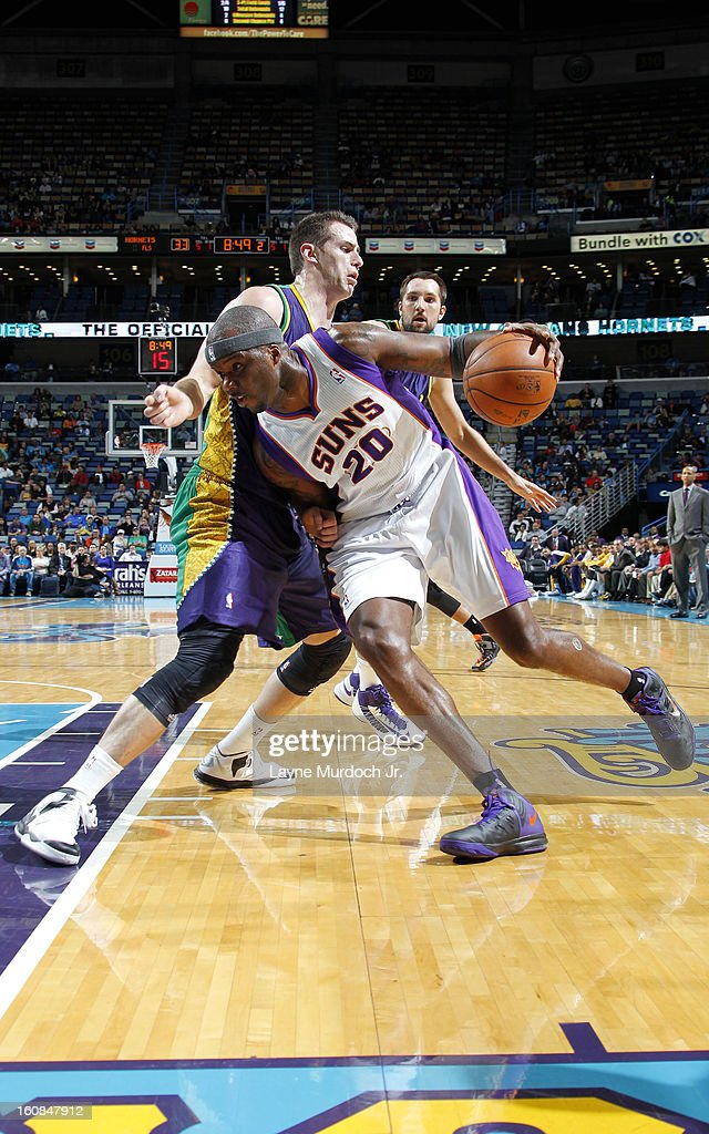 Jermaine O'Neal #20 of the Phoenix Suns drives to the basket against Jason Smith #14 of the New Orleans Hornets on February 06, 2013 at the New Orleans Arena in New Orleans, Louisiana.