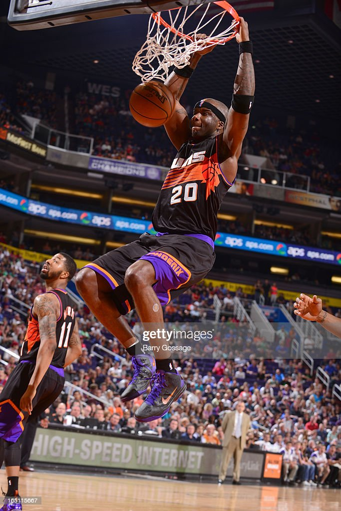 Jermaine O'Neal #20 of the Phoenix Suns dunks against the Indiana Pacers on March 30, 2013 at U.S. Airways Center in Phoenix, Arizona.