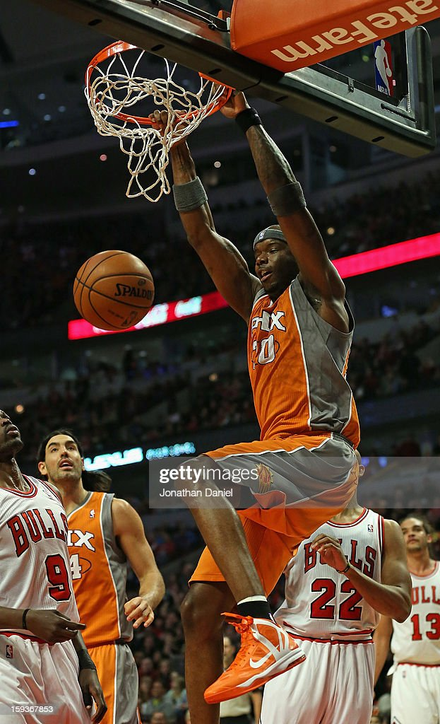 Jermaine O'Neal #20 of the Phoenix Suns dunks over Loul Deng #9 of the Chicago Bulls at the United Center on January 12, 2013 in Chicago, Illinois.