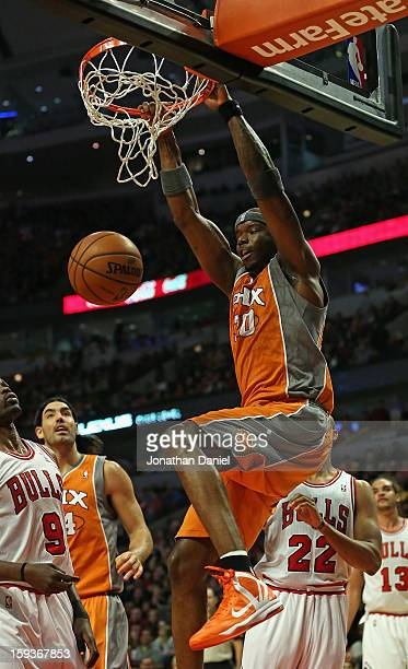 Jermaine O'Neal of the Phoenix Suns dunks over Loul Deng of the Chicago Bulls at the United Center on January 12 2013 in Chicago Illinois NOTE TO...