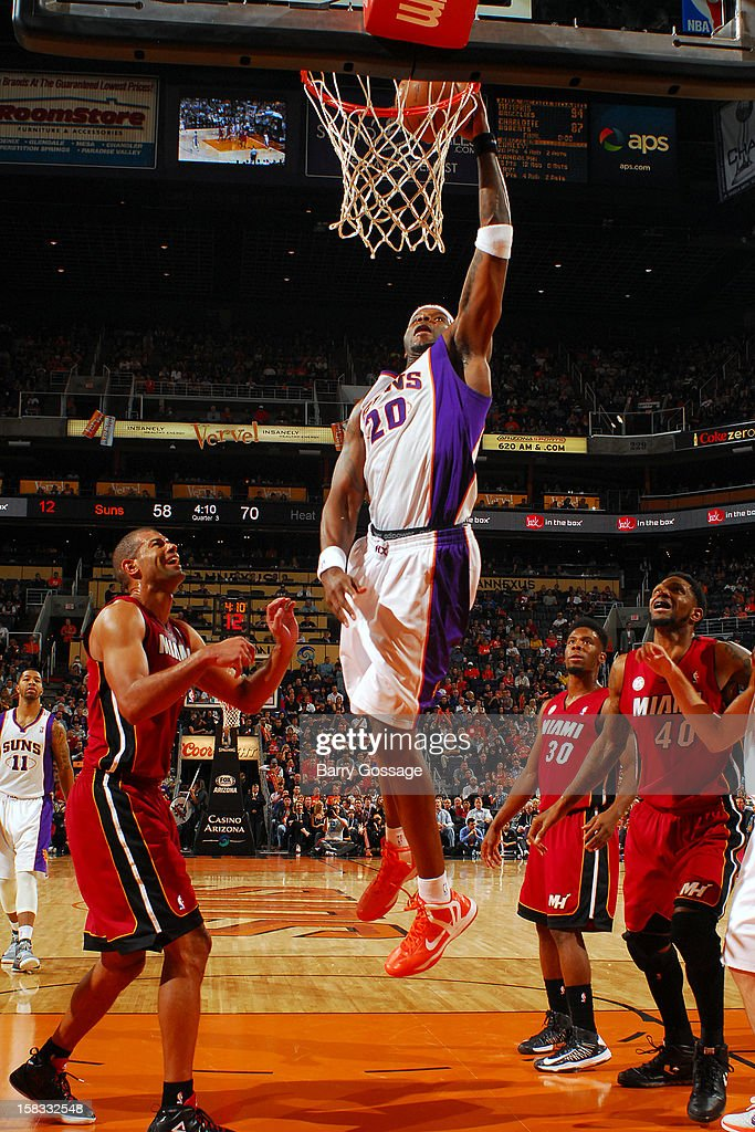 <a gi-track='captionPersonalityLinkClicked' href=/galleries/search?phrase=Jermaine+O%27Neal&family=editorial&specificpeople=201524 ng-click='$event.stopPropagation()'>Jermaine O'Neal</a> #20 of the Phoenix Suns dunks the ball against the Miami Heat on November 17, 2012 at U.S. Airways Center in Phoenix, Arizona.
