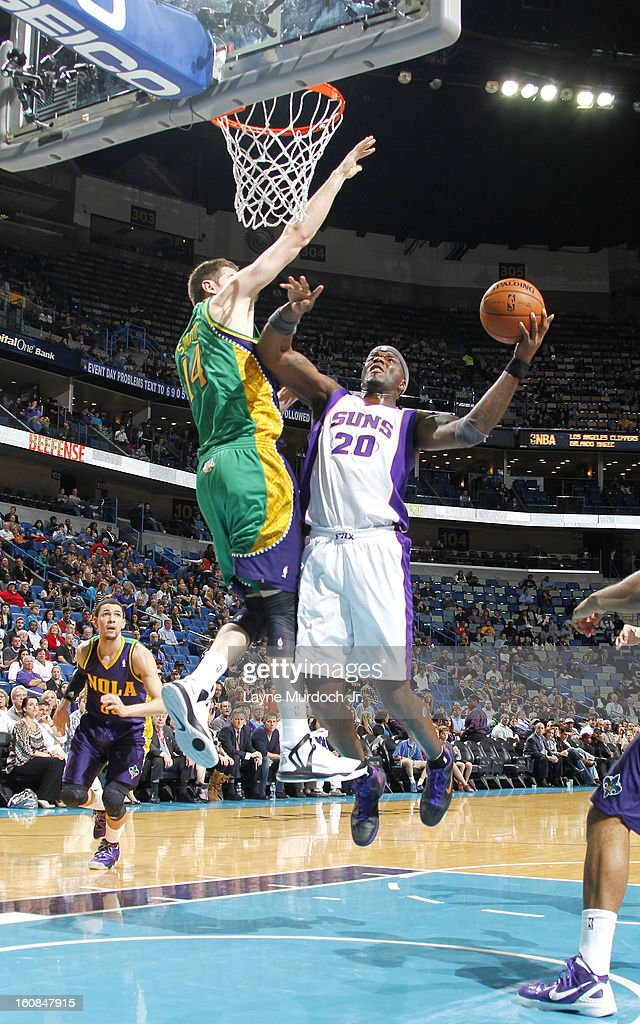 Jermaine O'Neal #20 of the Phoenix Suns goes to the basket against Jason Smith #14 of the New Orleans Hornets on February 06, 2013 at the New Orleans Arena in New Orleans, Louisiana.